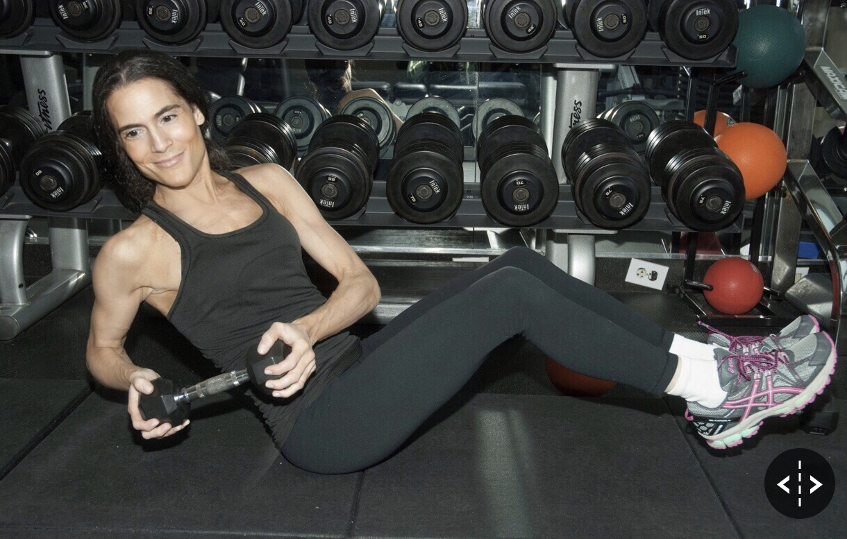 Dr. Alison Mitzner working out with weights, fitness advocate and mom expert