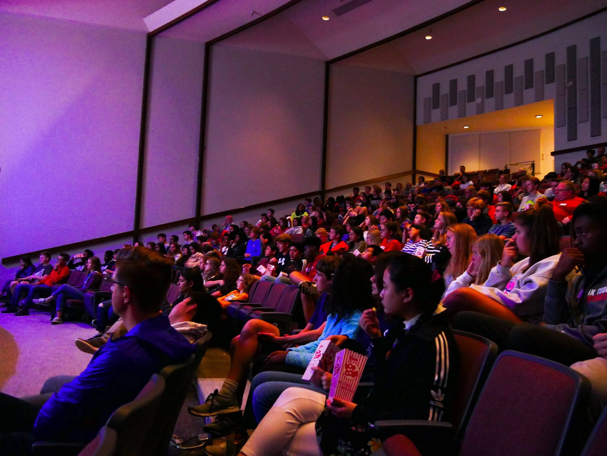 Park Tudor students and faculty watch filmmaker Julie Sokolow present Barefoot: The Mark Baumer Story. Photo by Park Tudor School.