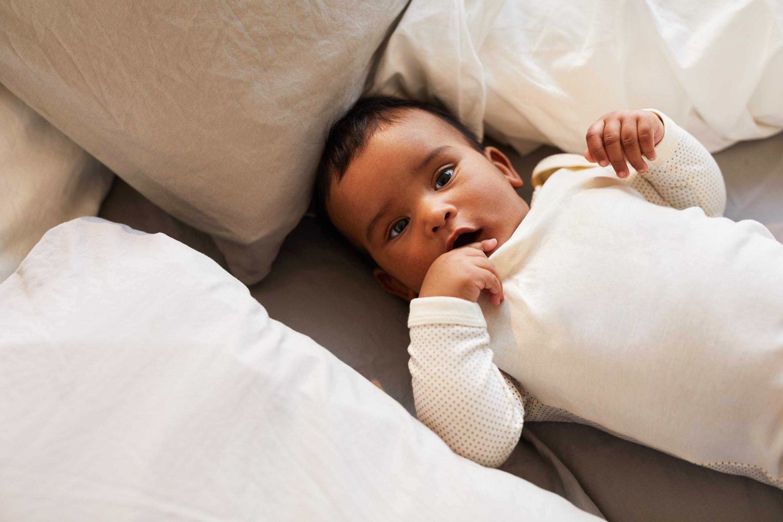 cute-baby-in-white-baby-suit-6K87QSC.jpg