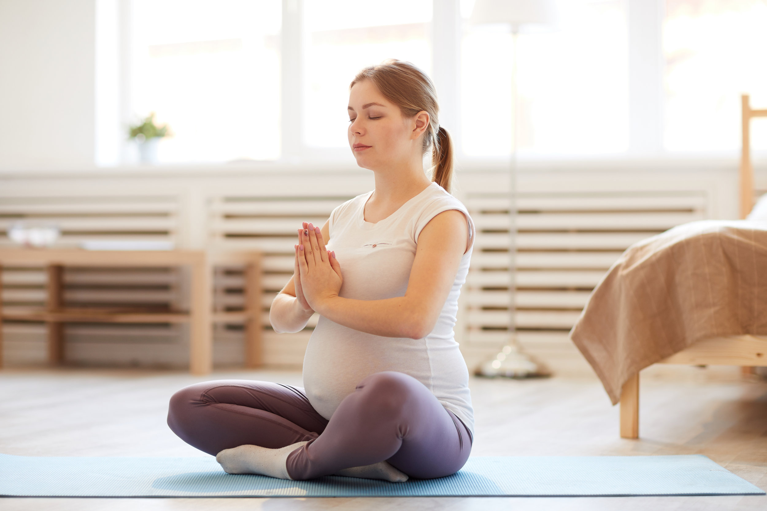 pregnant-woman-meditating-AP7ZUDL.jpg