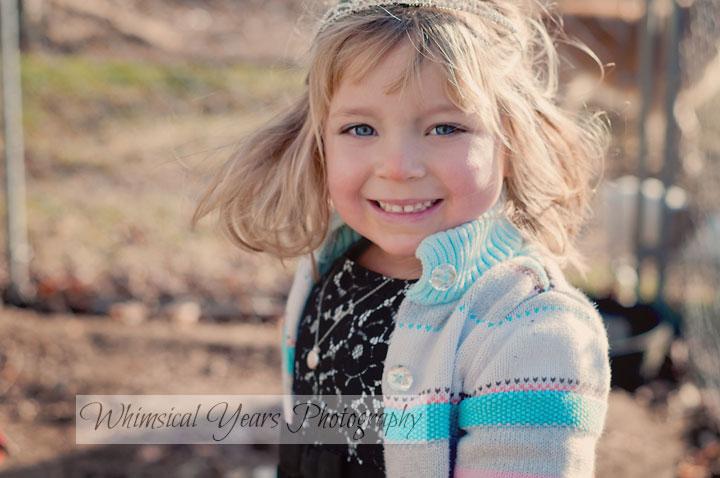 portrait of little blond girl wearing a tiara