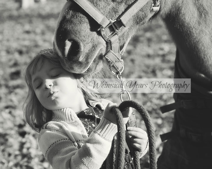 black and white photo of little girl and horse