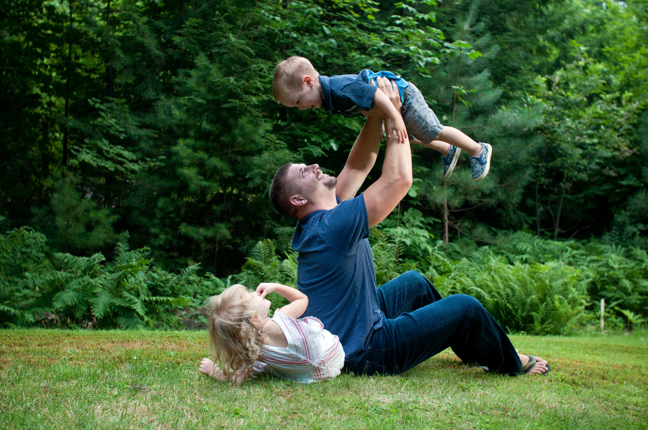 Father lifting his little boy in the air