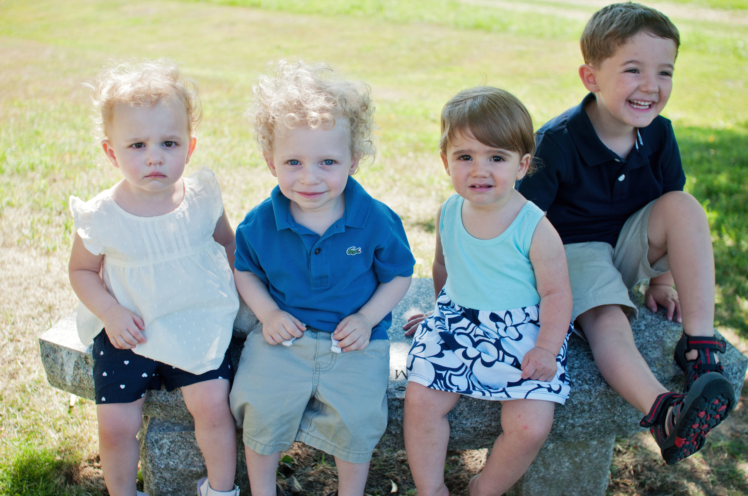 casual portrait of four very young children outdoors
