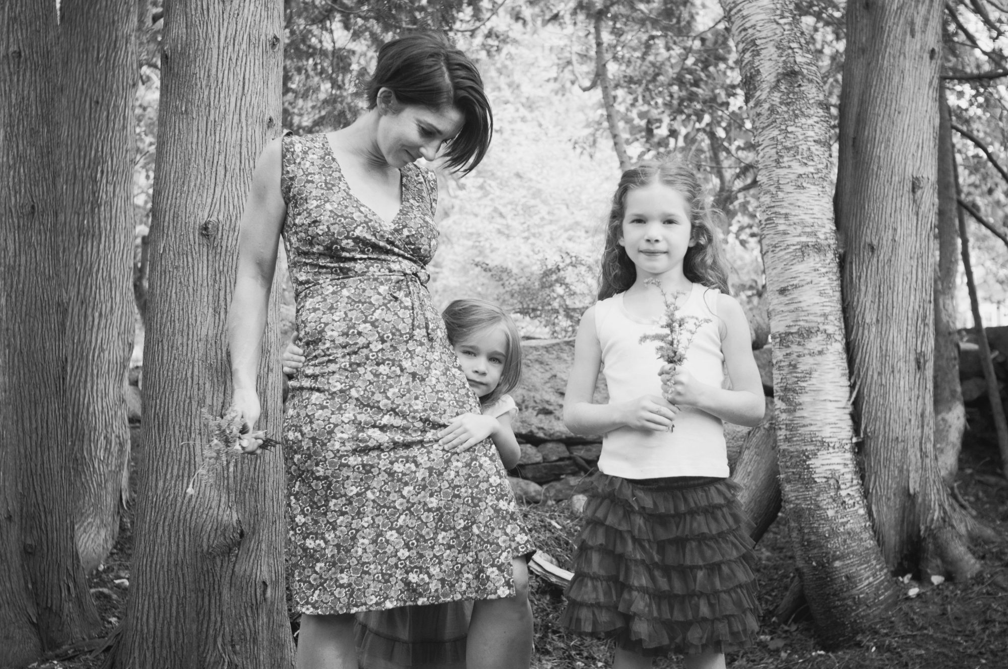 Black and white photo of mother and two daughers
