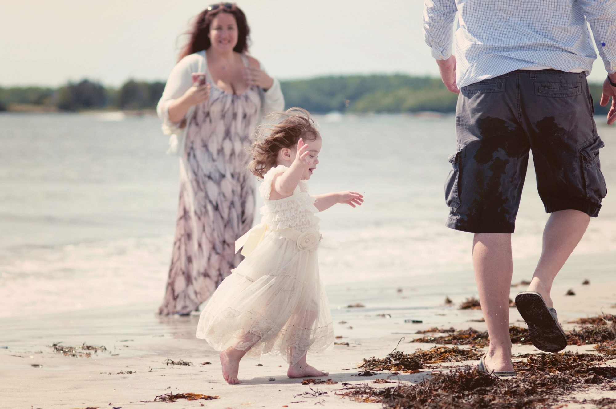 Little girl running at the beach in Pemaquid Maine
