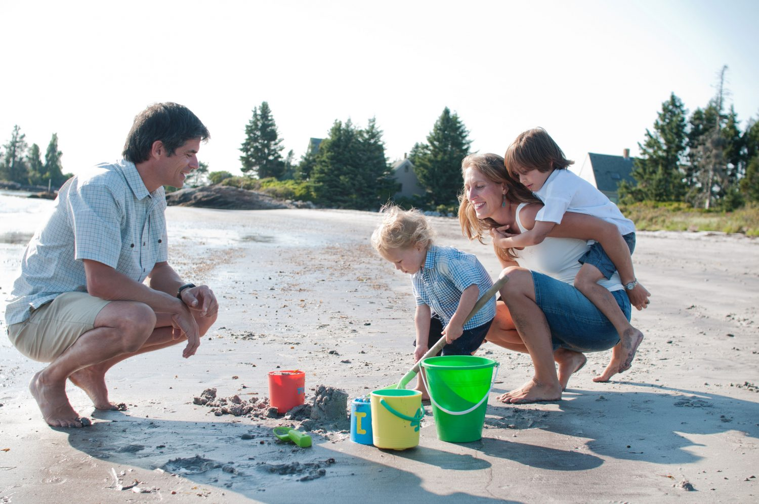 Family playing in the sand at Pemaquid Beach