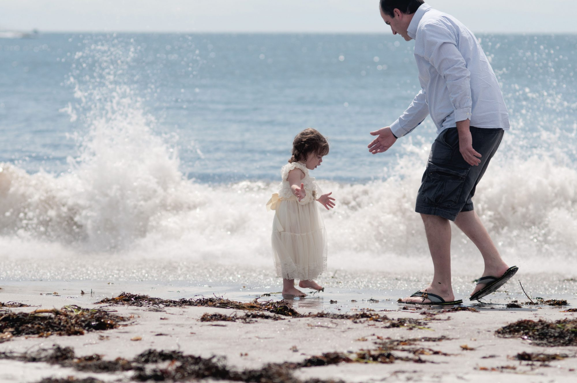 Child and father playing in the water at Pemaquid Beach