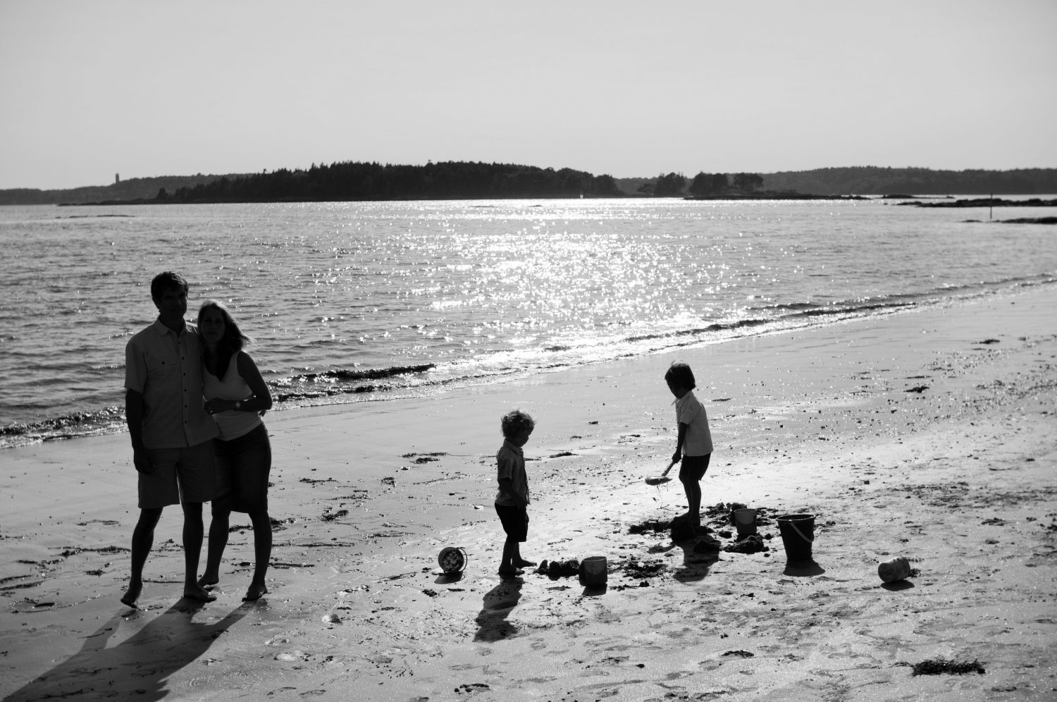Black and white silhouette photo of family at Pemaquid Beach