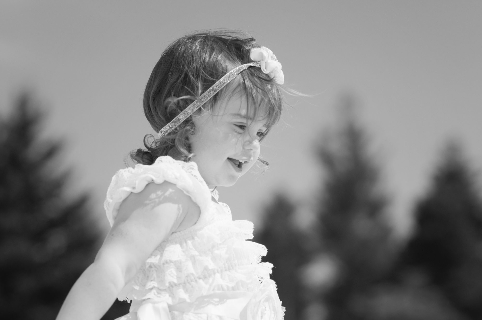 Black and white close up of little girl
