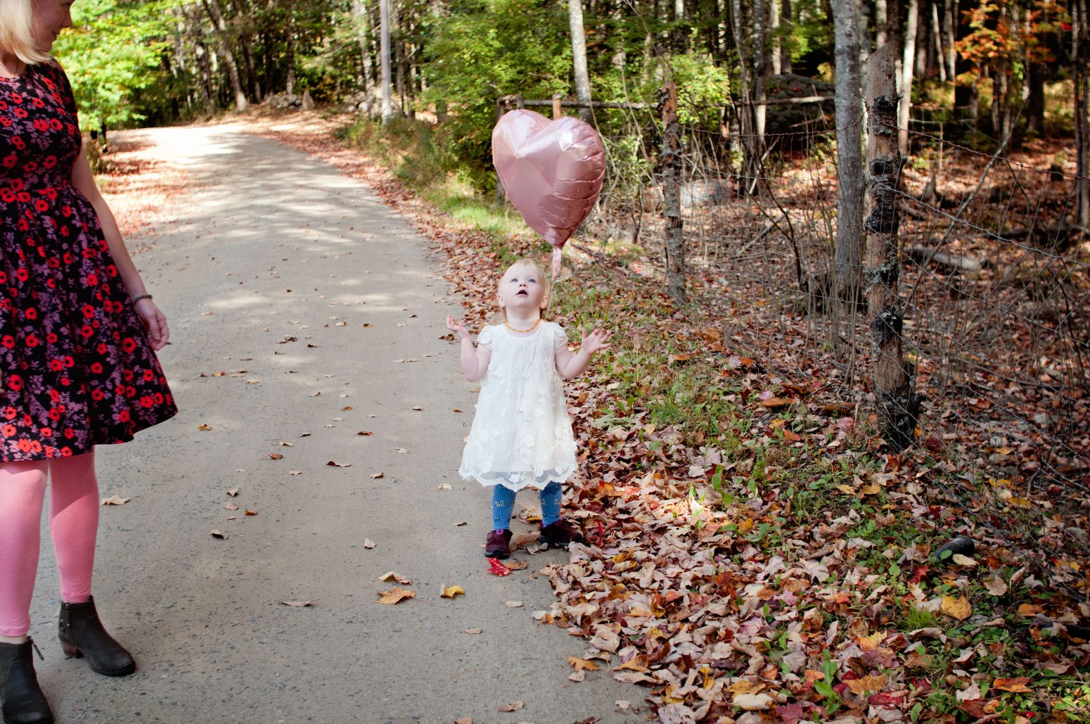 toddler girl and balloon