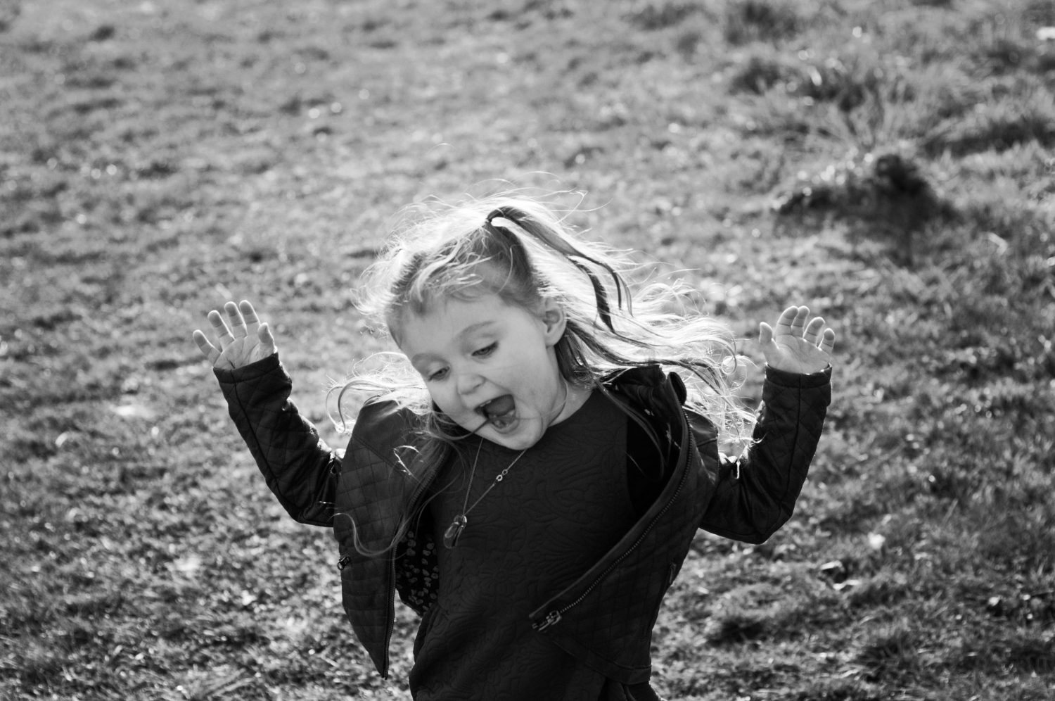 black and white photo of girl being silly