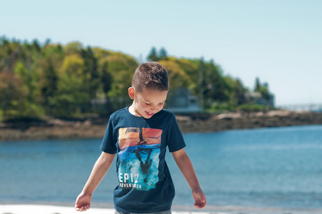 little boy smiling at pemaquid beach