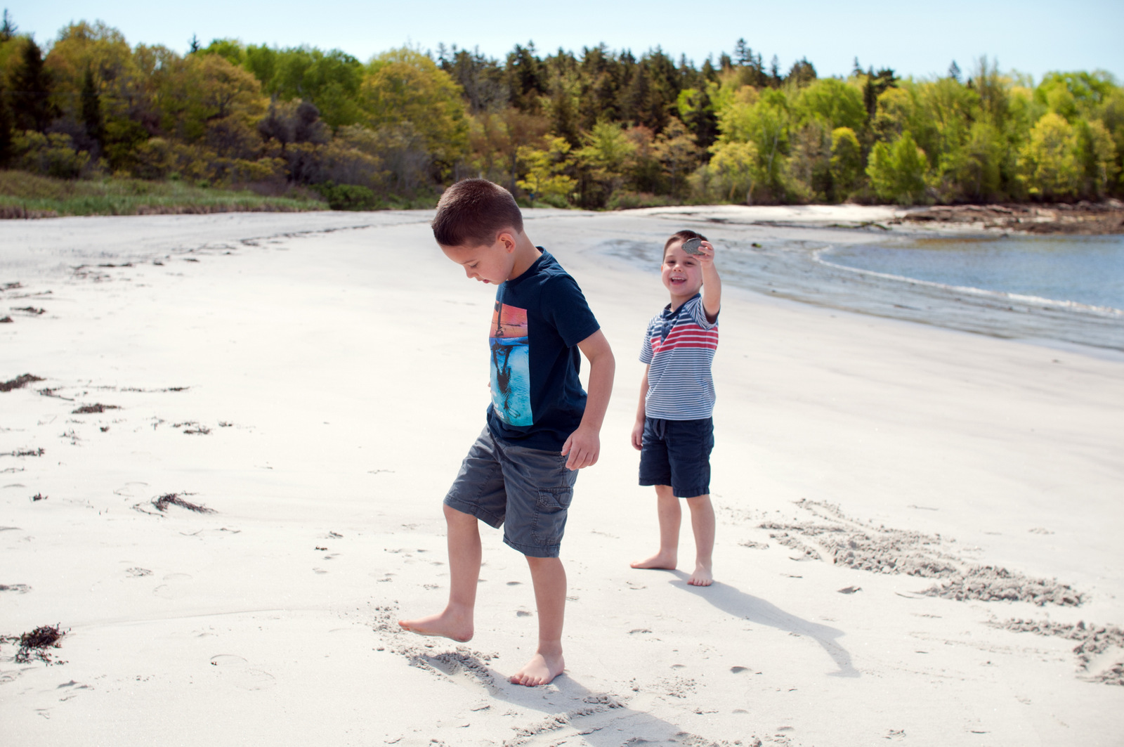 two boys playing at Pemaquid Beach