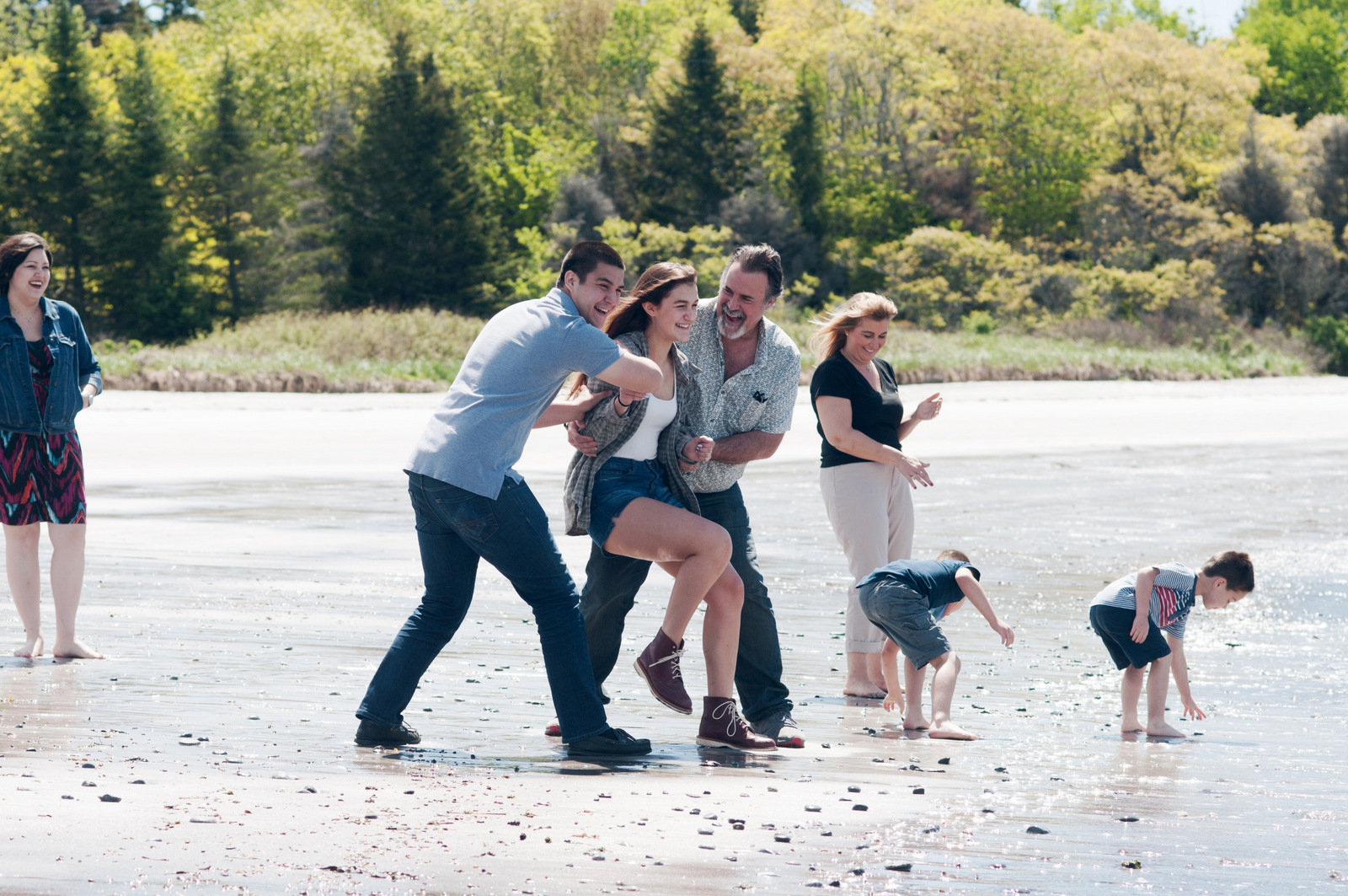 family playing and laughing together at Pemaquid Beach