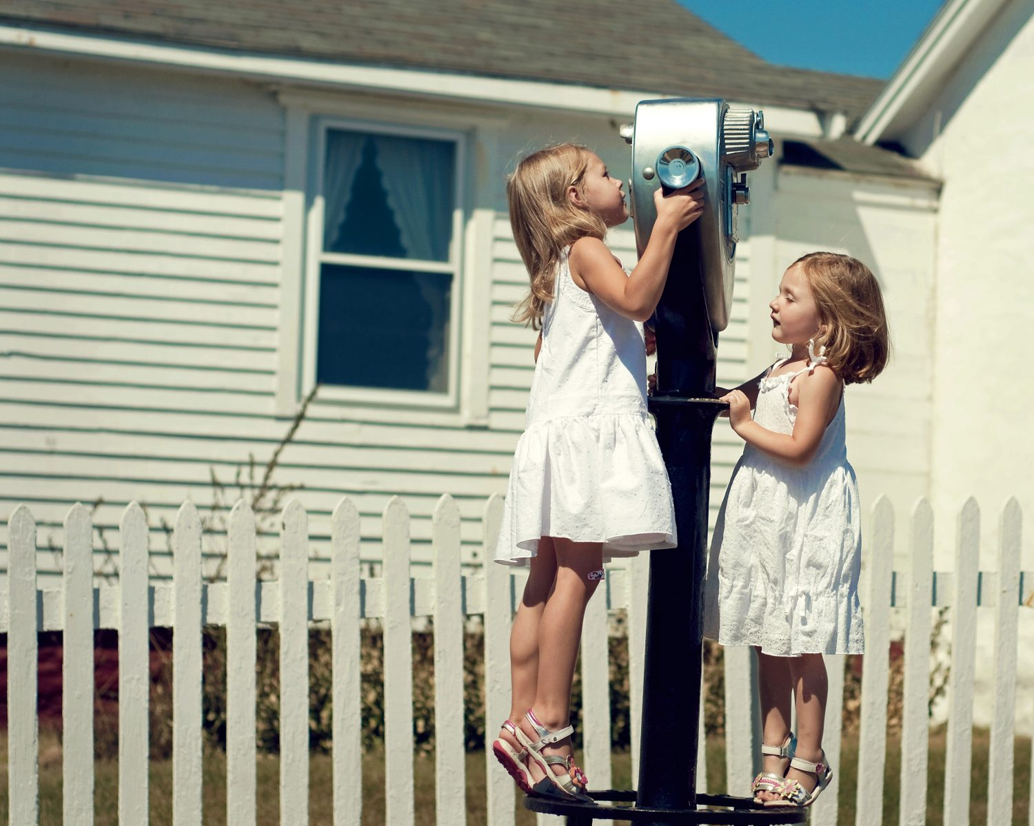 two little girls looking at Pemaquid Lighthouse