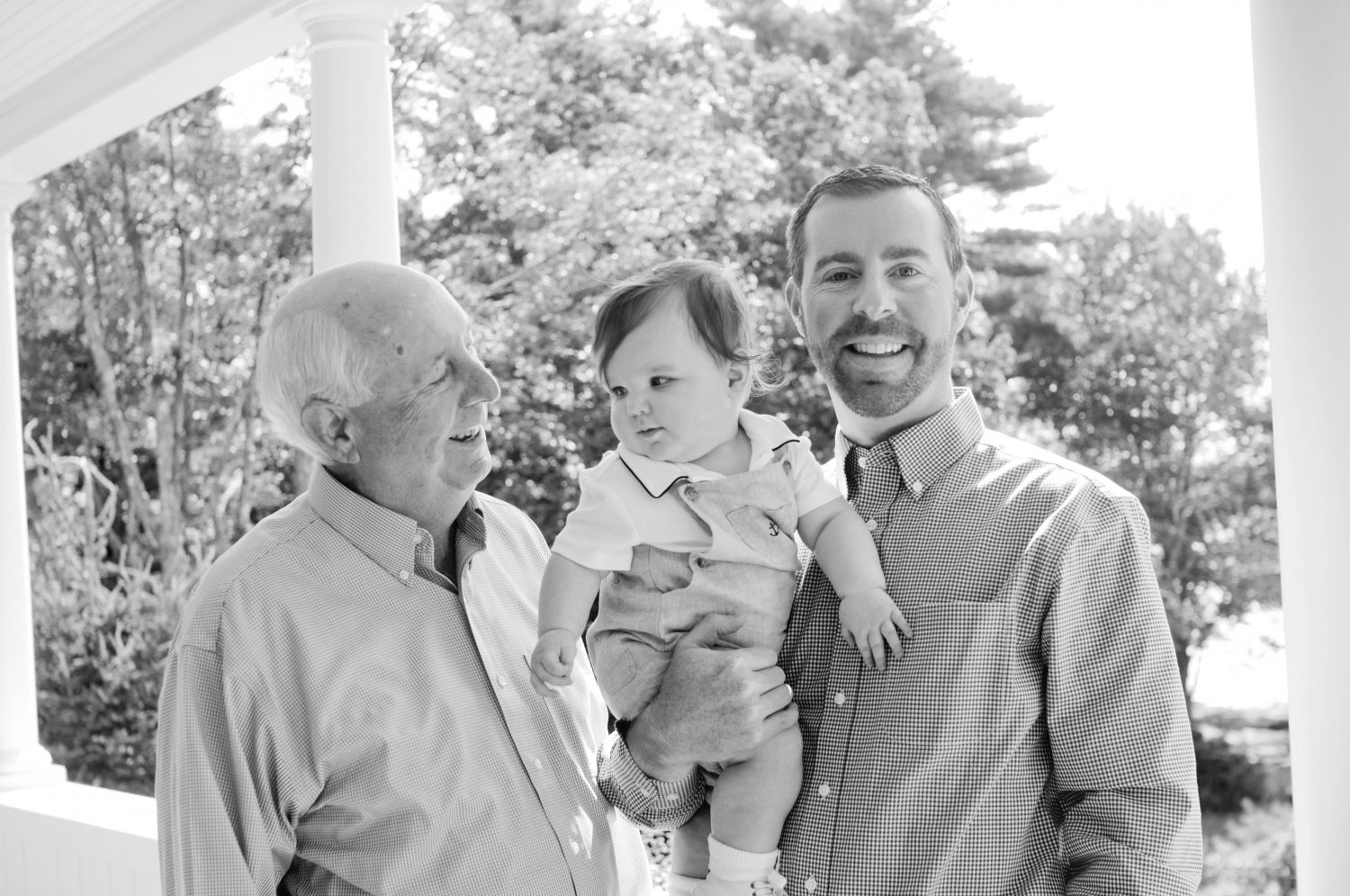 three generations of boys - grandfather, son and grandson baby