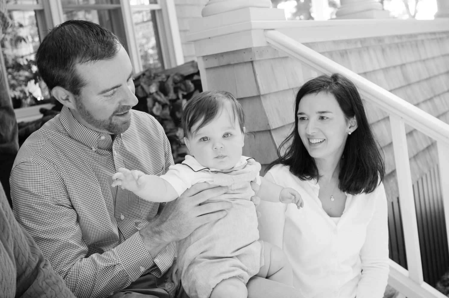 black and white candid photo of family of three