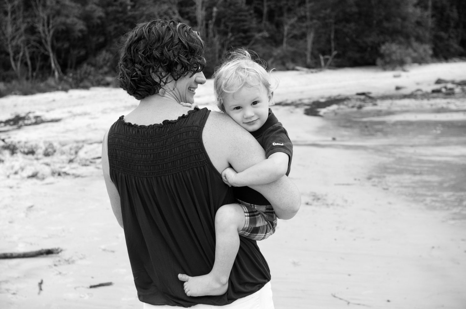 Black_and_white_photo_of_mother_holding_toddler_son