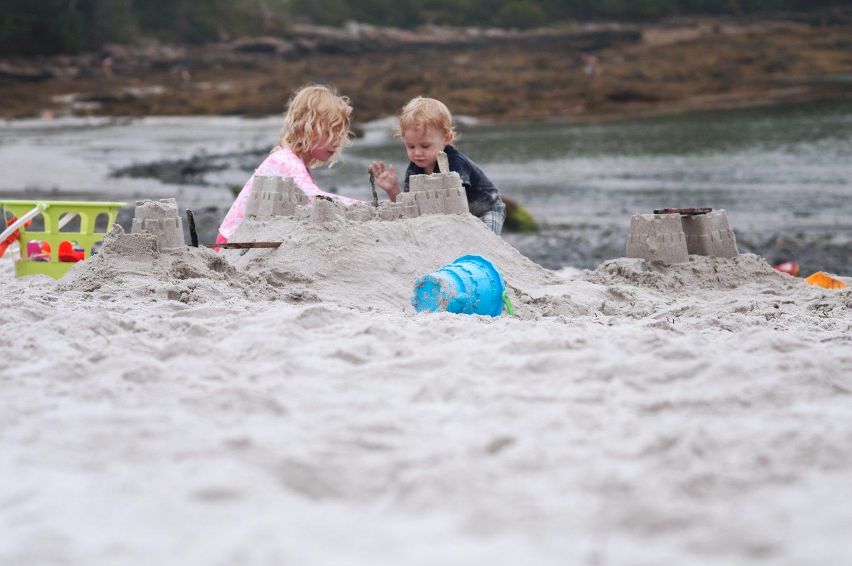 Siblings_playing_at_Pemaquid_Beach