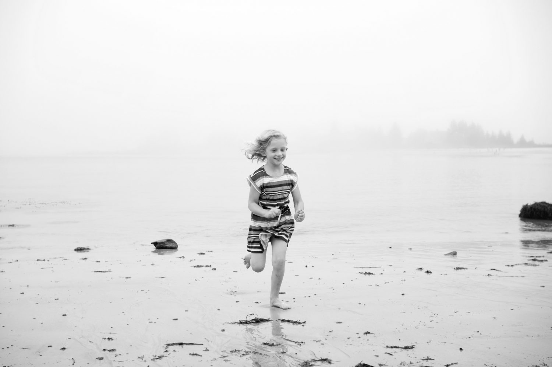 Young_girl_running_at_Pemaquid_Beach