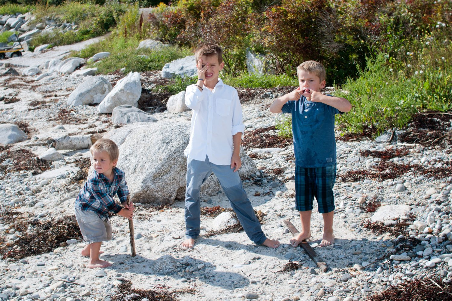 silly photo of three young boys on the beach