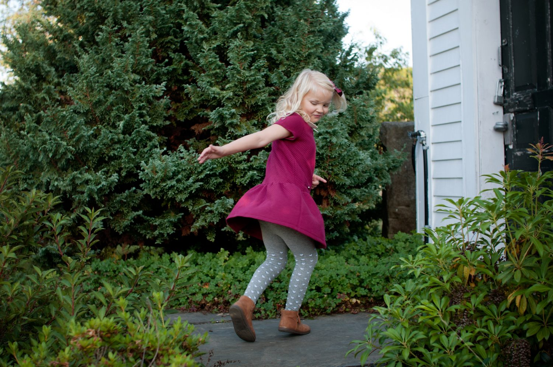 little blond girl twirling