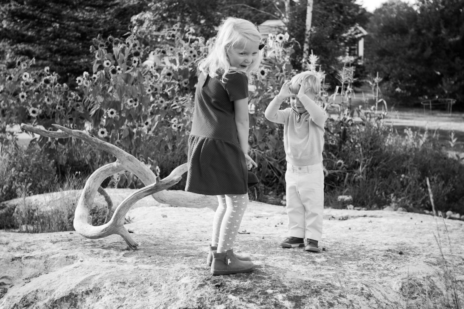 a pair of young siblings being silly during photoshoot