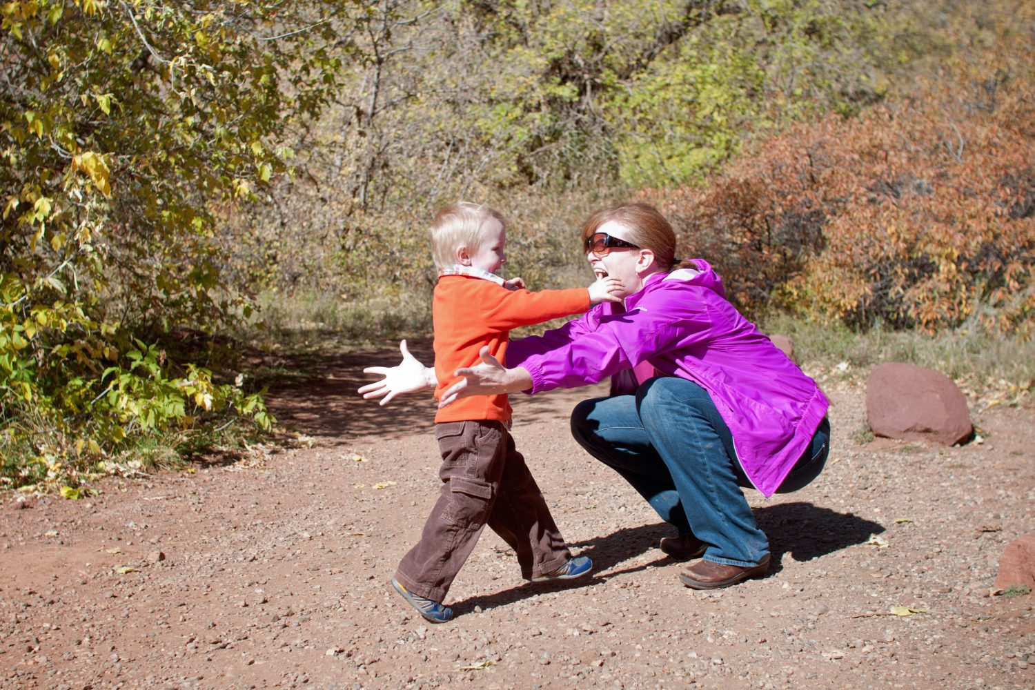 toddler son running into his mother's arms