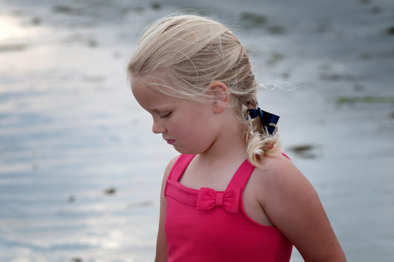 profile photo of young girl wearing a single braid