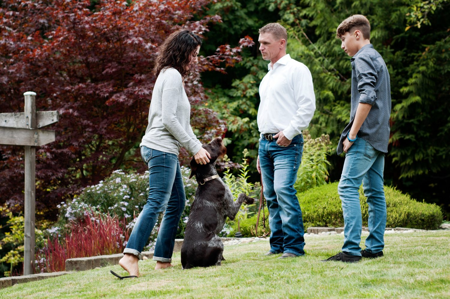 family of three with dog