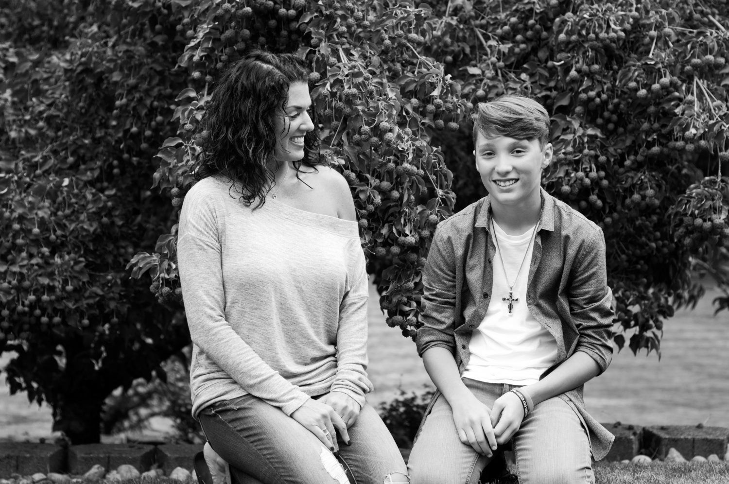 black and white image of mother and teenage son