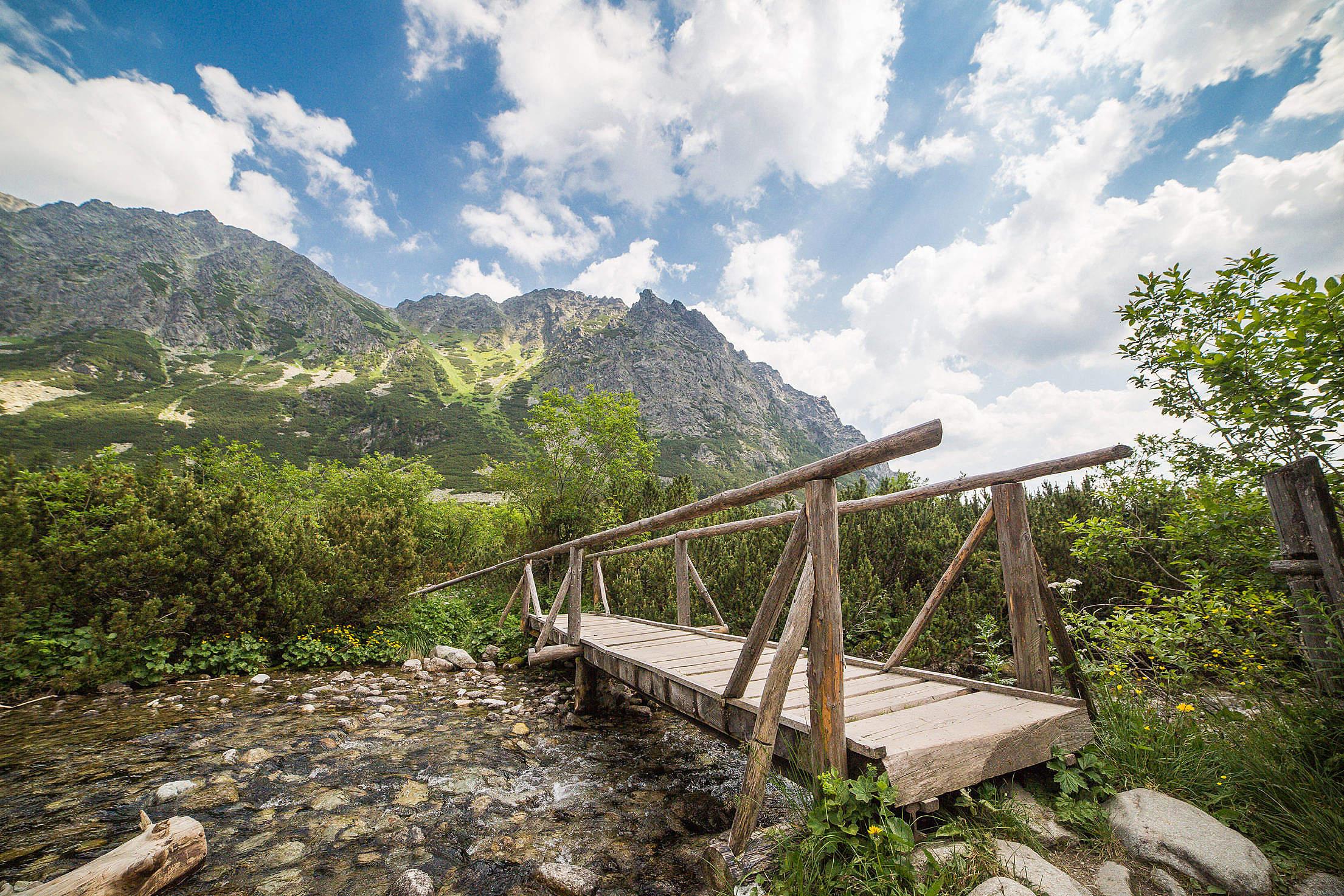from https://picjumbo.com/wp-content/uploads/wooden-bridge-in-high-tatras-mountains_free_stock_photos_picjumbo_HNCK7678-2210x1474.jpg