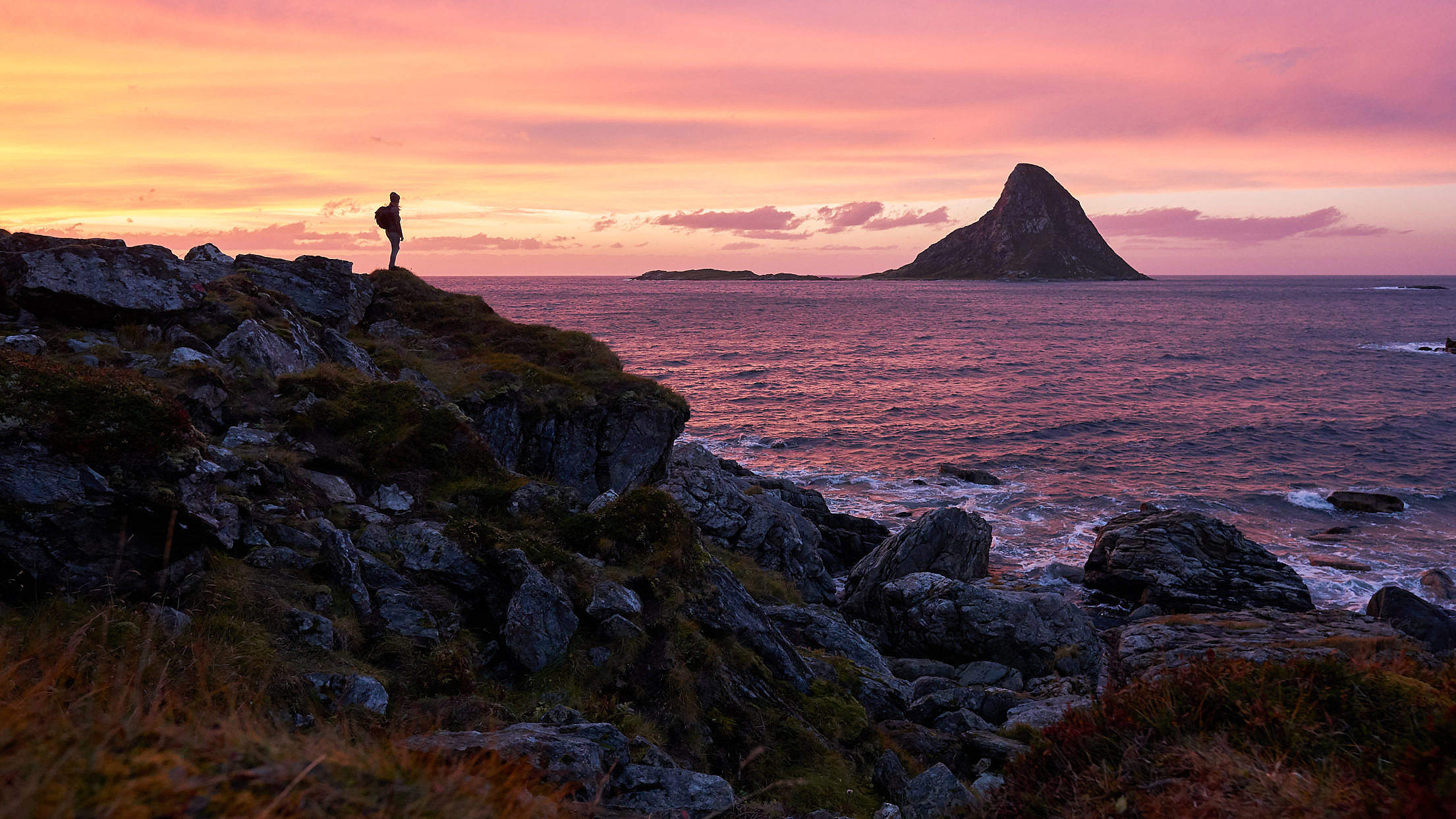 a-woman-enjoying-the-view-from-the-coast-of-northern-norway-2210x1243[1].jpg