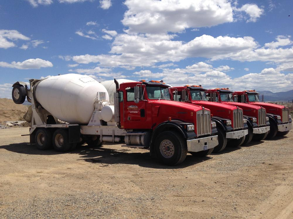 """Rear Discharge Mixer Trucks - All of our rear discharge mixer trucks:-8.5 cubic yards capacity-Reach 16' from the back bumper-Height: 11' 8""""-Width: 8'"""