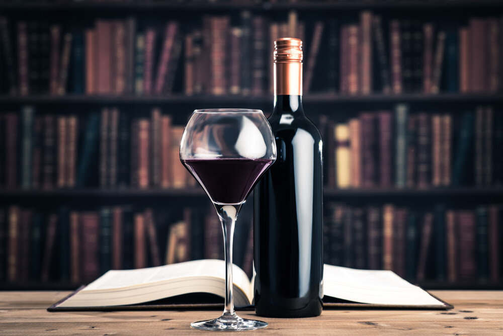 Read More Co. - Who doesn't like a glass of wine with a good book?!