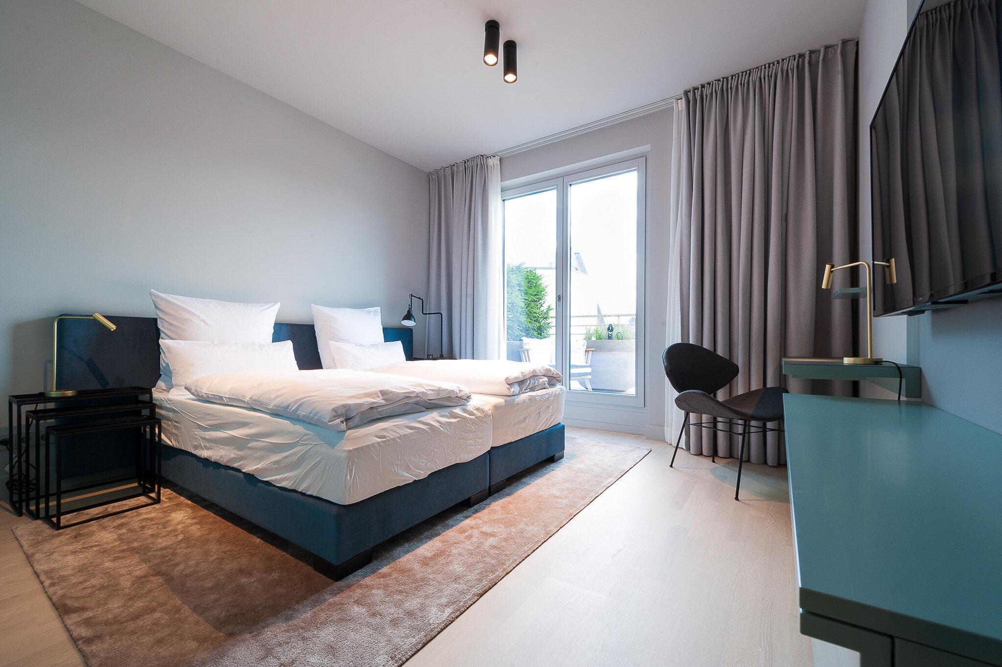 Betten im Schlafzimmer des Apartment