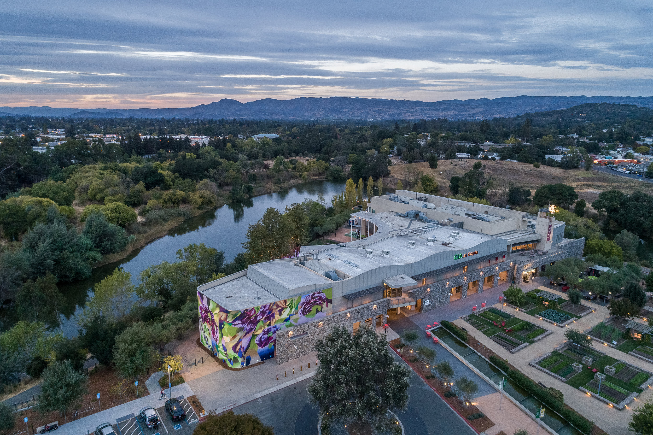 A bird's eye view of The Culinary Institute of America at Copia, located in Napa's Oxbow District, surrounded by the Napa River