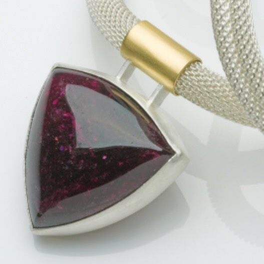 A lovely big, dark red tourmaline asking to be made into a pendant. #tourmaline #silver #18ctgold #pendant #necklace #oneofakindjewellery #goldsmithsfair2019