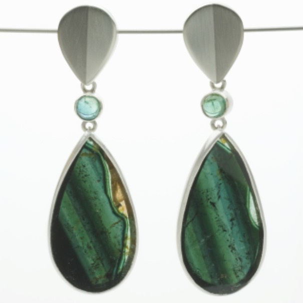 Slices of green tourmaline. I'm looking forward to showing them at #goldsmithsfair2019 Week 1, stand 18. #earrings #tourmaline #silver #palladium #contemporaryjewellery #oneofakind