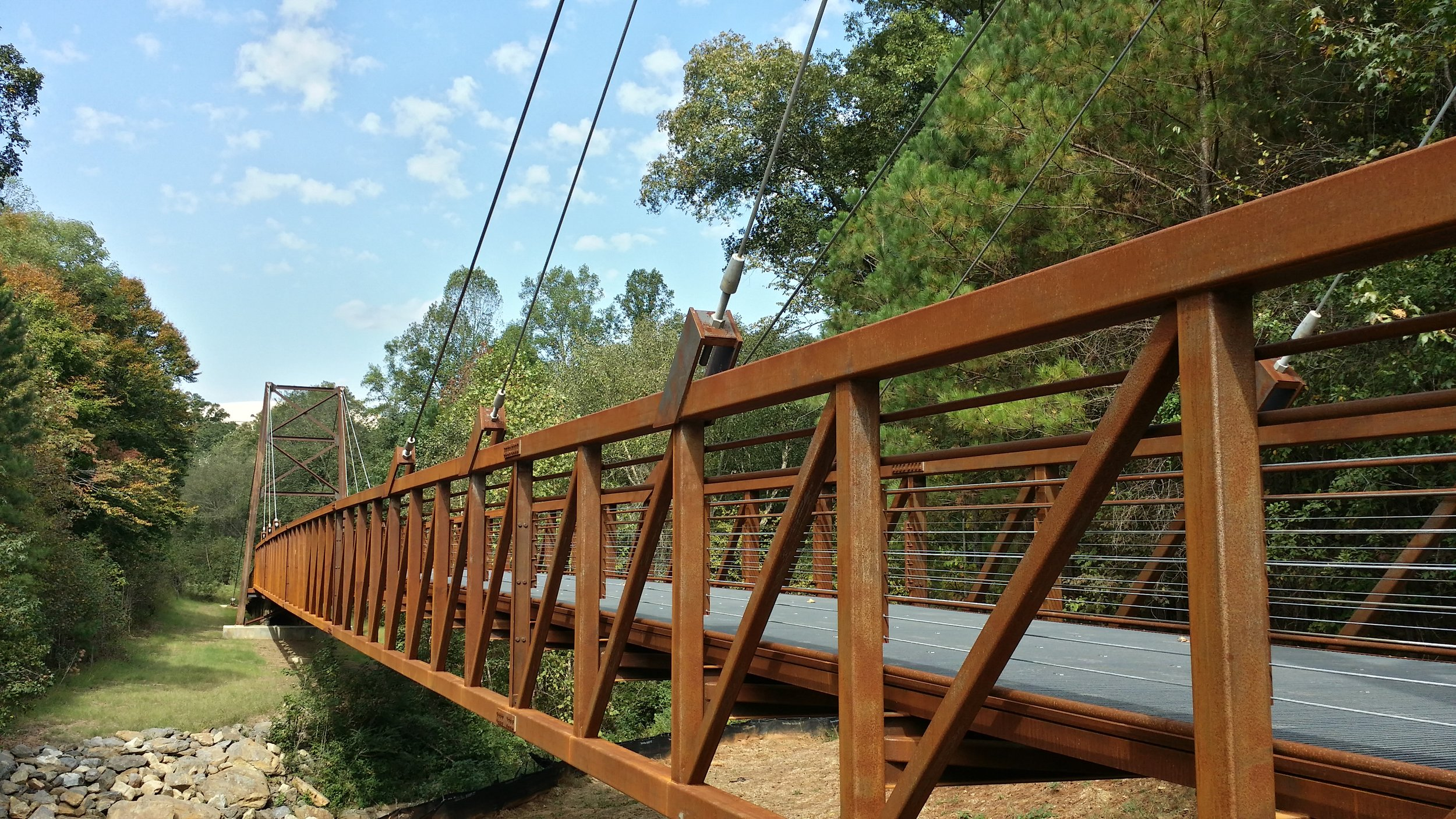 Ivy Creek Greenway - ClientGwinnett County Parks & RecreationLocationBuford, GABrief Project DescriptionAstra completed Ivy Creek Greenway for Gwinnett County from the ground up. The project consisted of asphalt trails and boardwalks for bikes and pedestrians and a beautiful suspension bridge.