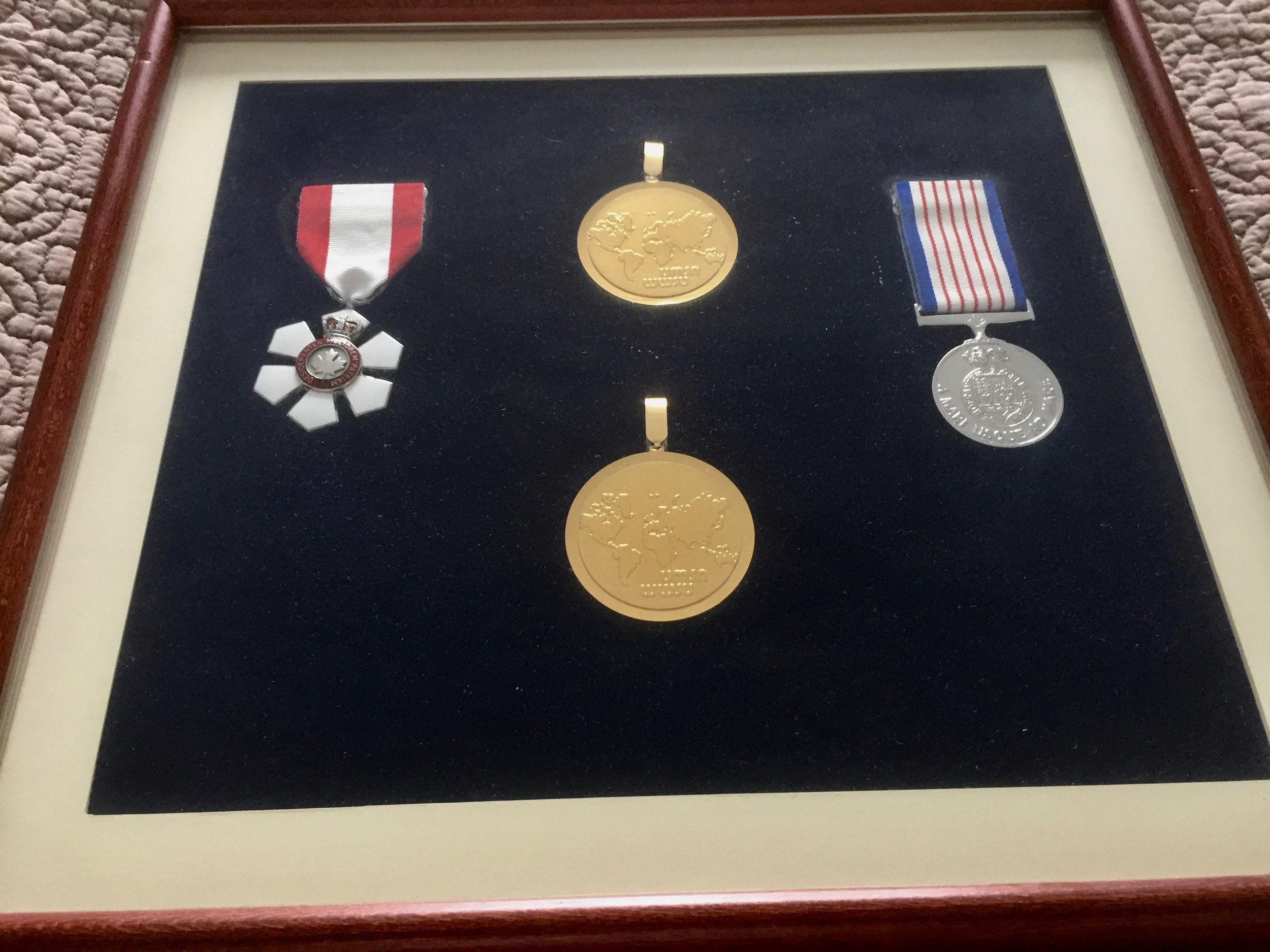 Order of Canada & World Champion Overall Medals