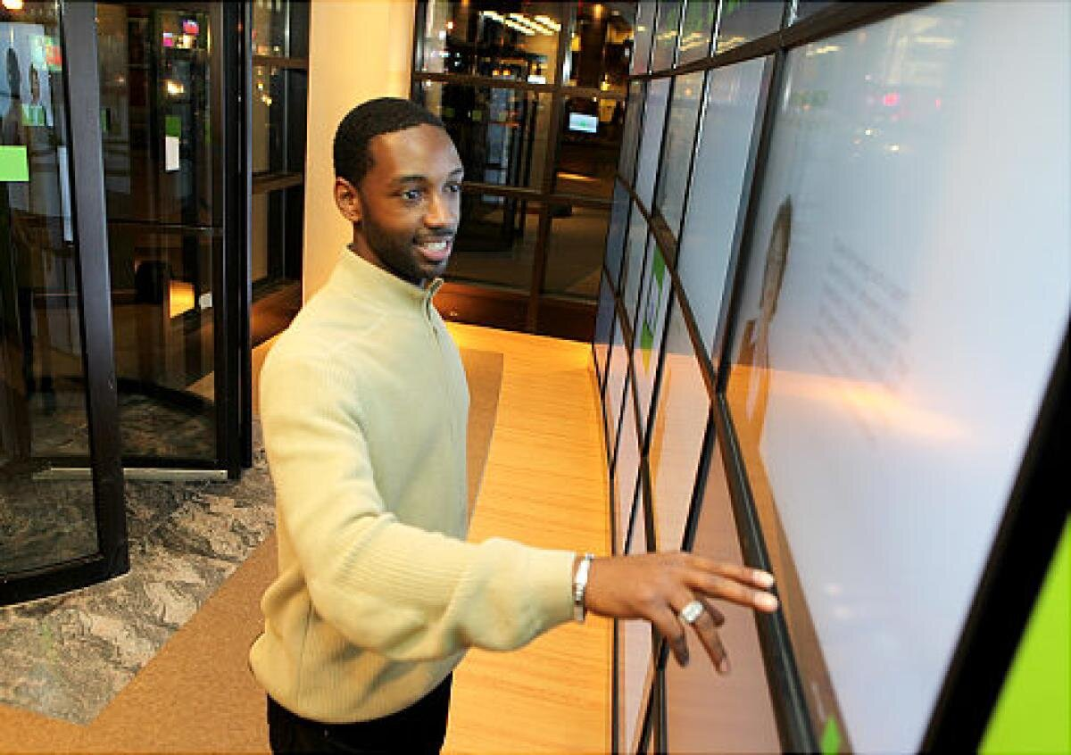The Main Video Wall includes five touch-enabled displays where Tax Clients can set up appointments, determine which documents they need for their appointment, and find a Tax Pro suited to their needs. The screens are activated with motion sensors which interrupt the attractor loop video content.  Photo credit, Gabel for  New York Daily News