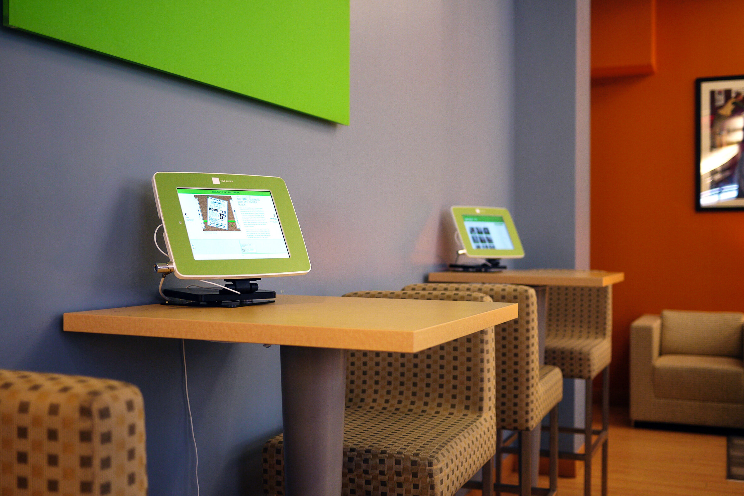 Interactive App Kiosks  — The iPad kiosks are secured to two cafe tables in the lobby.