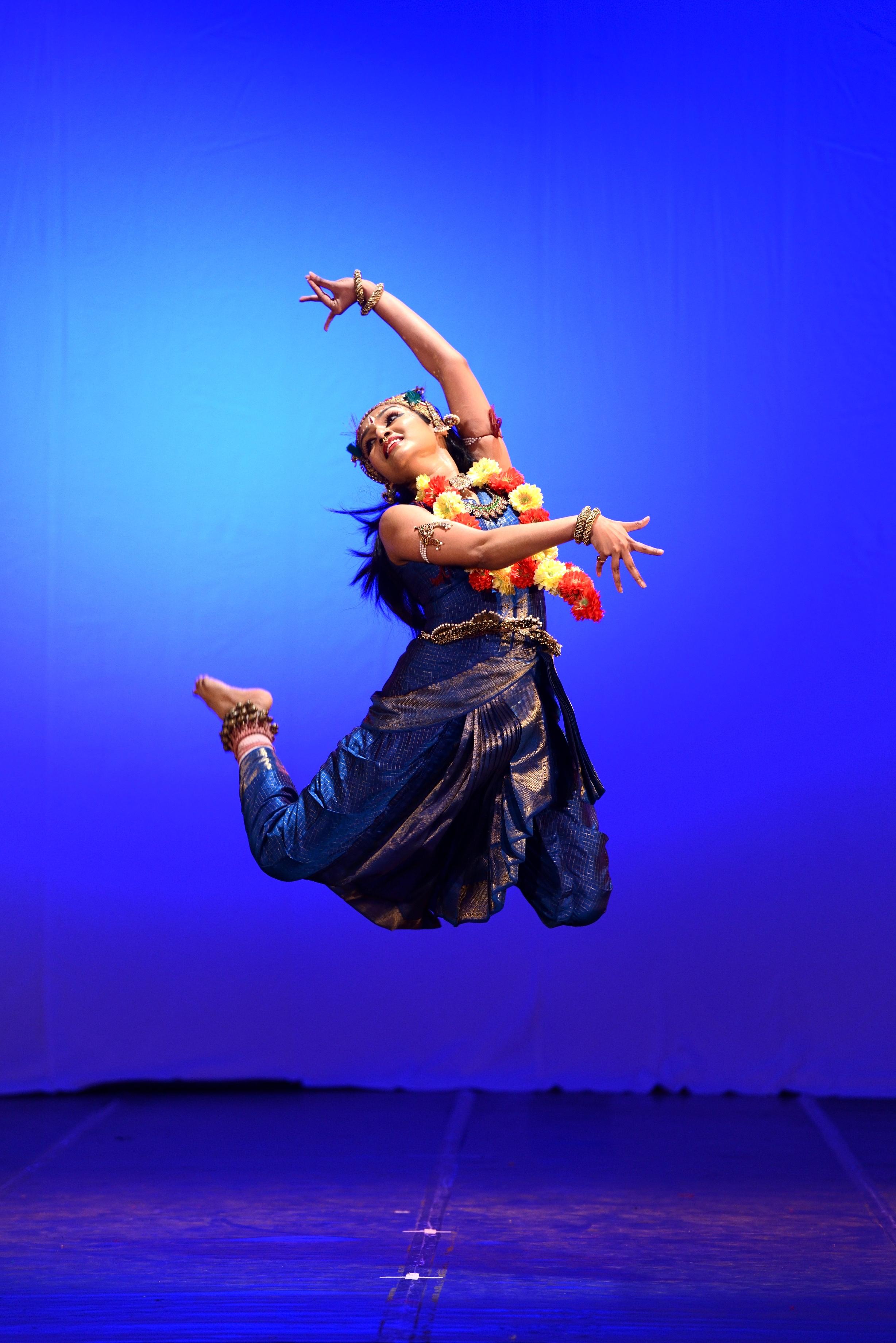 Krishna joyously dancing on the serpents head