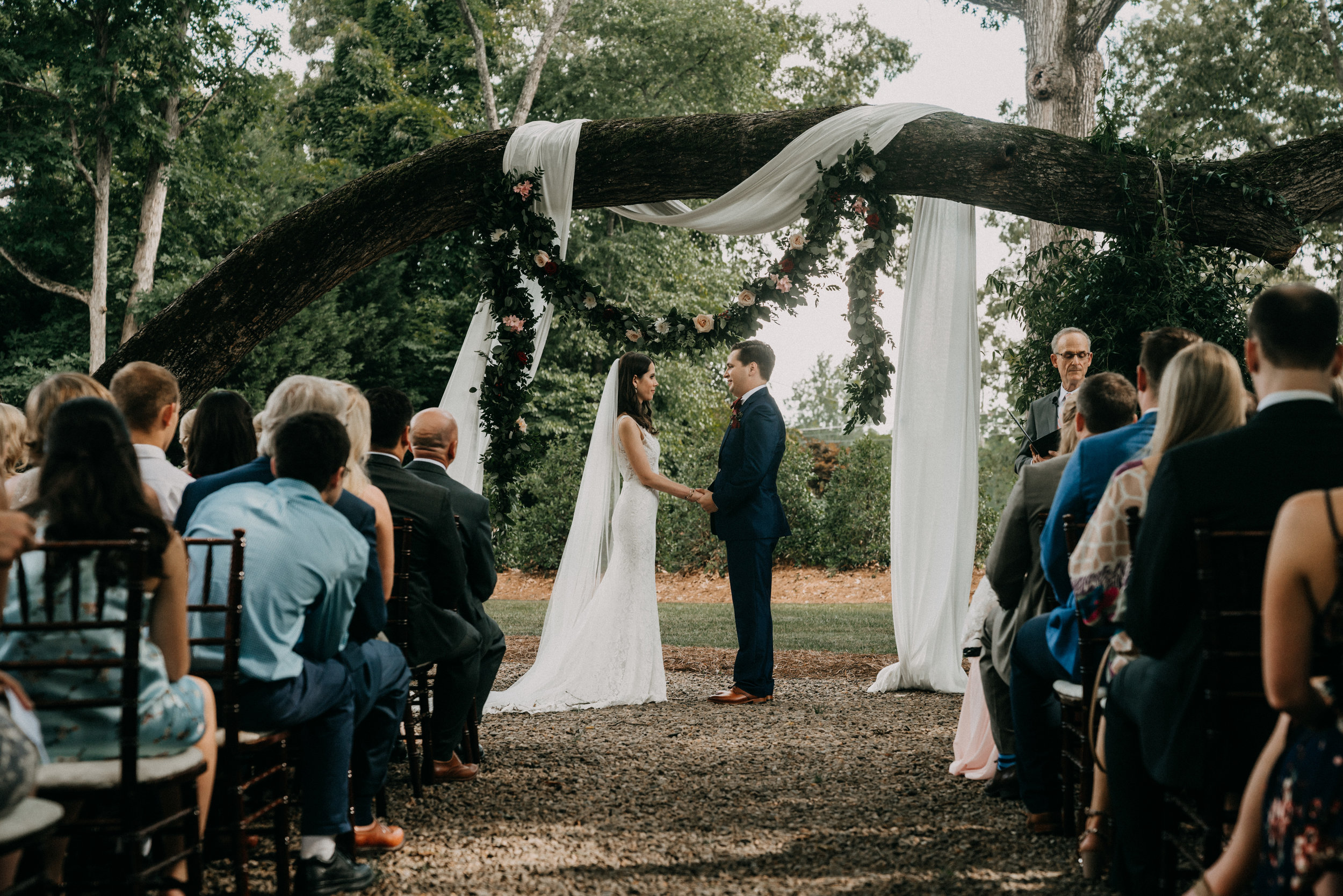 outdoor whitehead manor wedding in charlotte nc - Under a canopy of trees, Shellie and Jarrett tied the knot and partied the night away in Charlotte, North Carolina.
