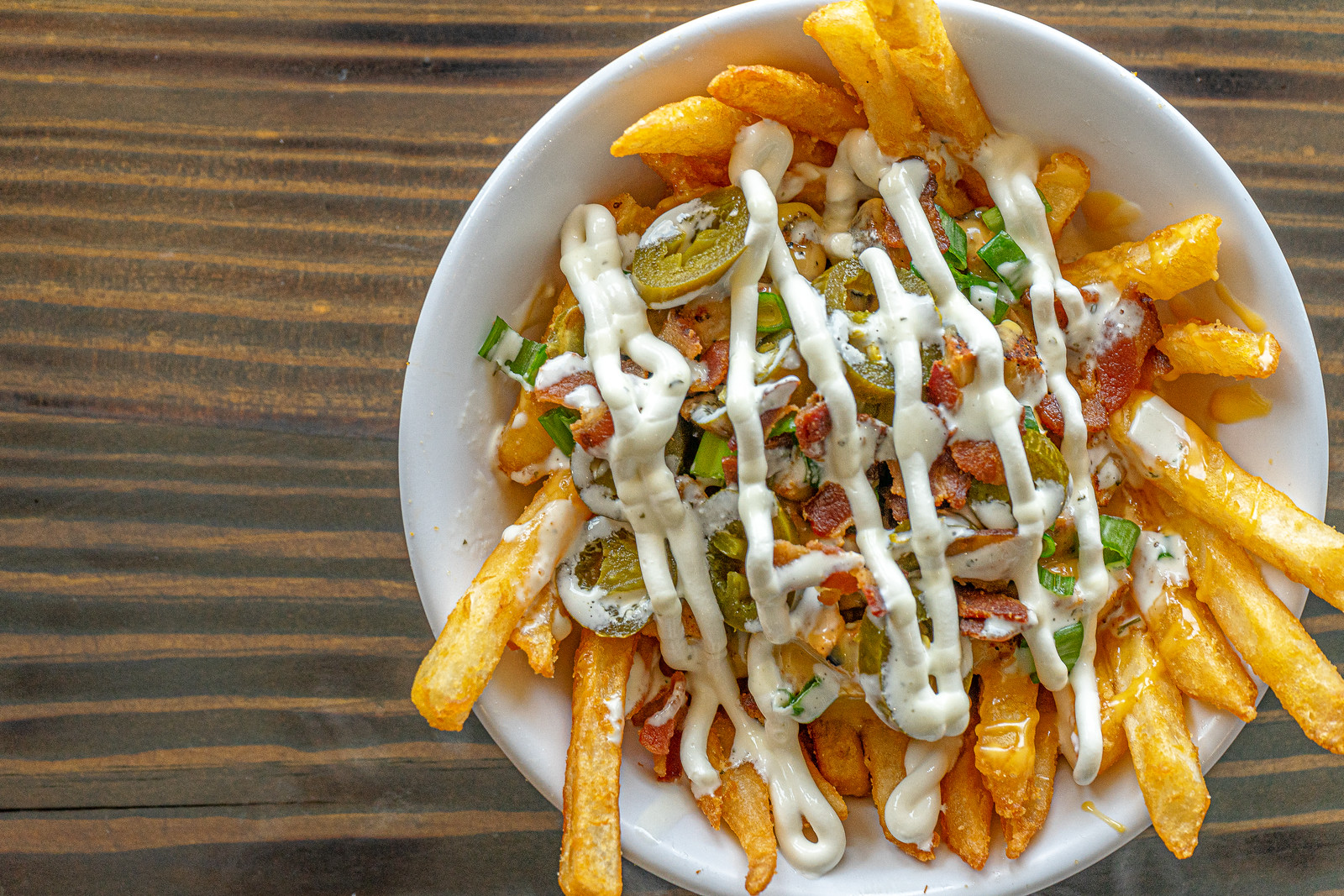 French Fries - Battered French fries cooked to a golden brown. Served hot and made to order! Add ¢50