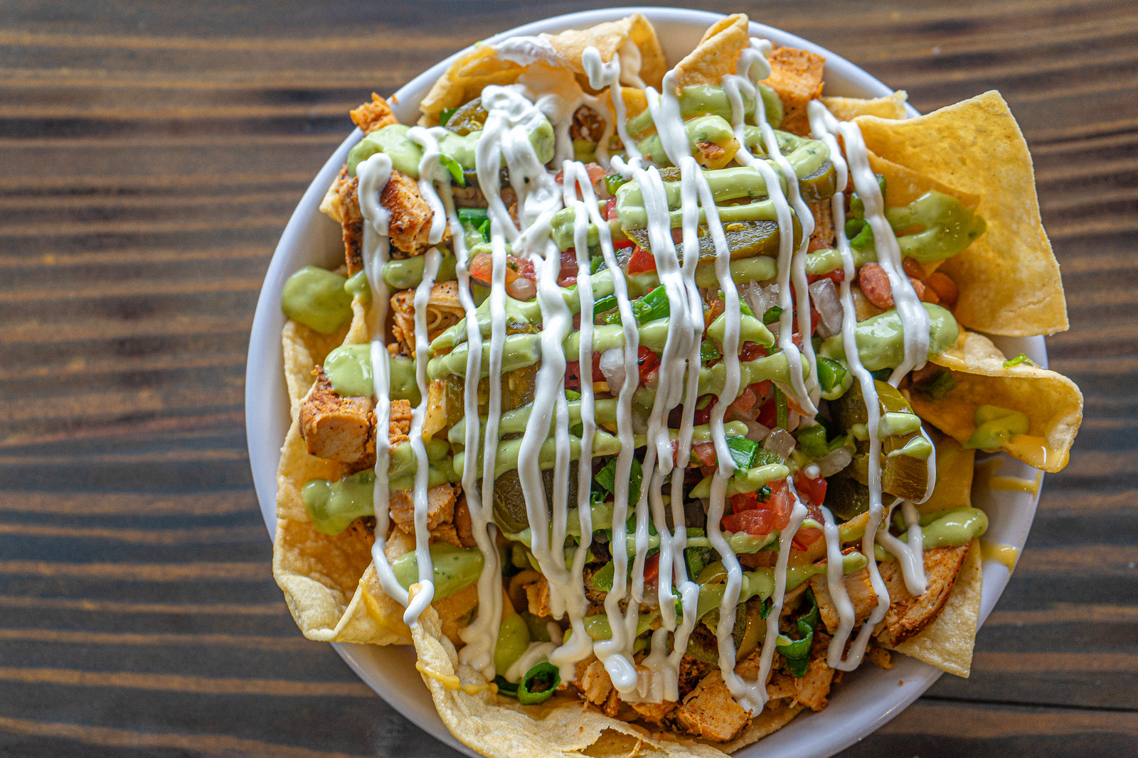 Tortilla Chips - The staple of our nachos, we take locally made corn tortillas and fry them in house. They are durable and can handle anything you pile on top!