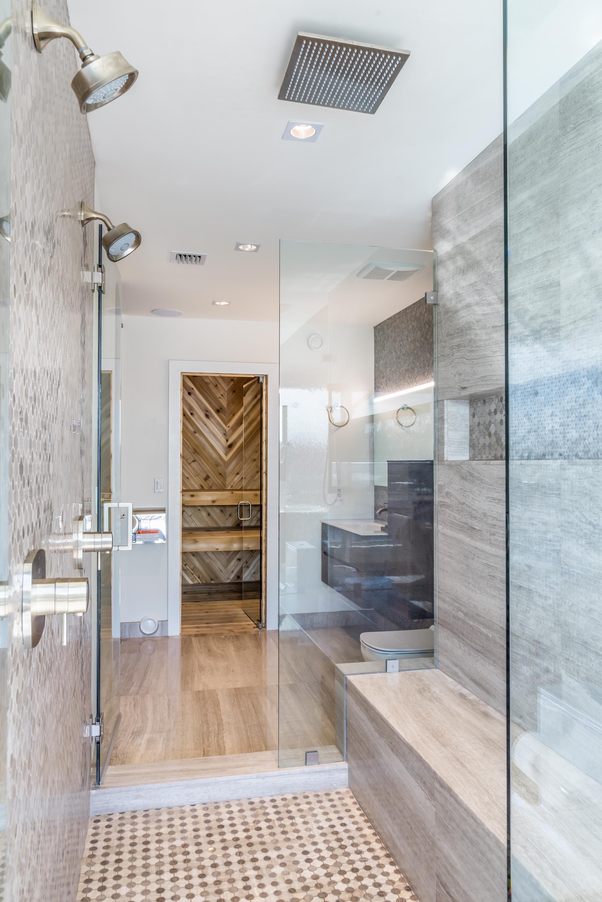 Bathroom with shower metalheads, glass door, hardwood floor and sauna