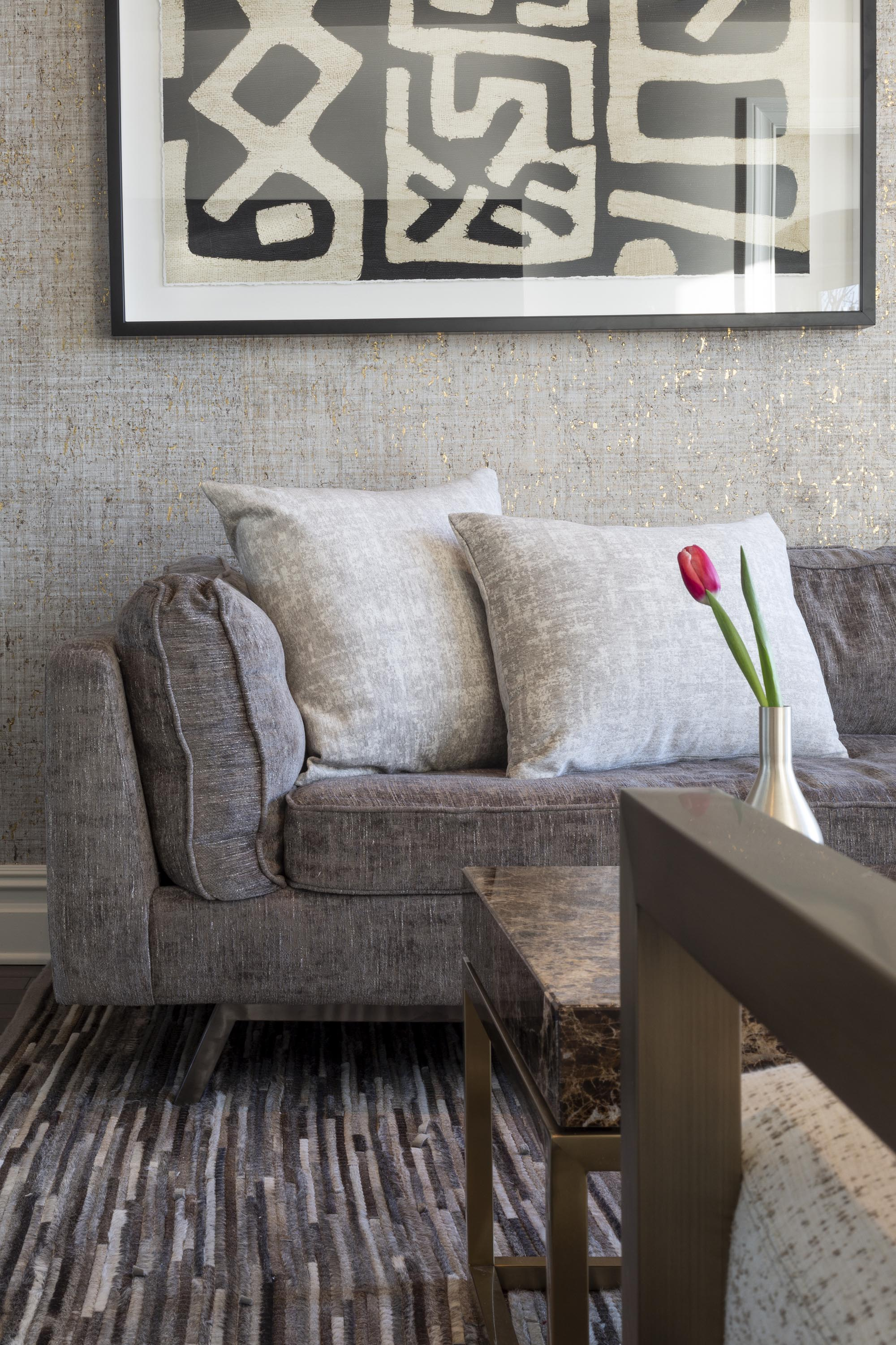 Living room with modern wallpaper, sofa and pillows